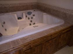 Hot tub installation with surrounding tile work in Walnut Shade, MO